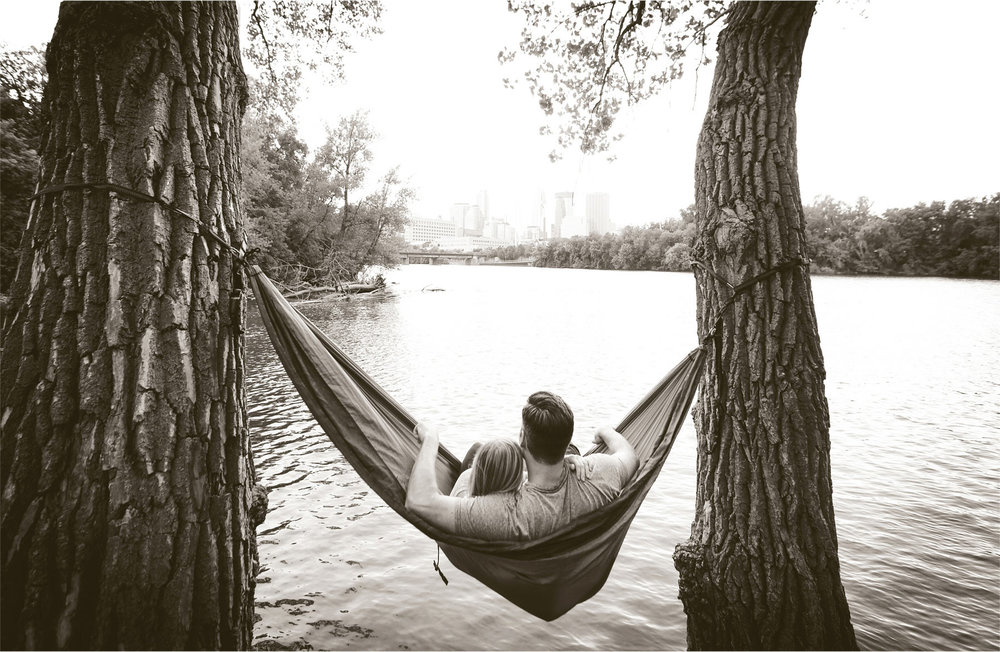 12-Minneapolis-Minnesota-Engagement-Photographer-by-Andrew-Vick-Photography-Summer-Mississippi-River-Hammock-Embrace-Cuddling-Sepia-Tina-and-Kevin.jpg
