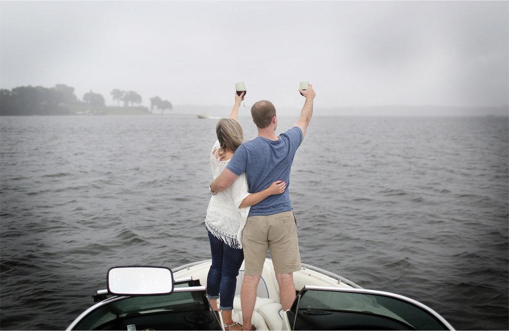 09-Wayzata-Minnesota-Engagement-Photographer-by-Andrew-Vick-Photography-Summer-Lake-Minnetonka-Embrace-Wine-Rain-Umbrella-Speed-Boat-Ashley-&-Kasey.jpg