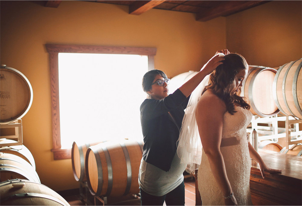 03-Cannon-Falls-Minnesota-Wedding-Photographer-by-Andrew-Vick-Photography-Summer-River-Winery-Getting-Ready-Bride-Bridesmaid-Veil-Wine-Barrels-Vintage-Becca-and-Donal.jpg