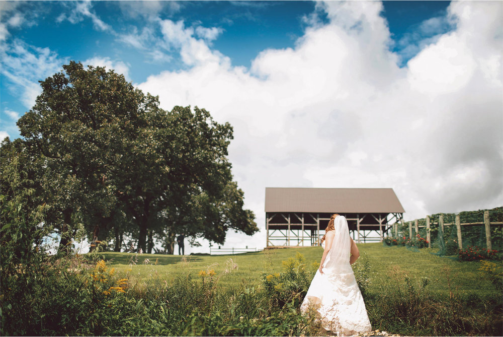 05-Cannon-Falls-Minnesota-Wedding-Photographer-by-Andrew-Vick-Photography-Summer-River-Winery-First-Meeting-Look-Bride-Groom-Field-Vintage-Becca-and-Donal.jpg