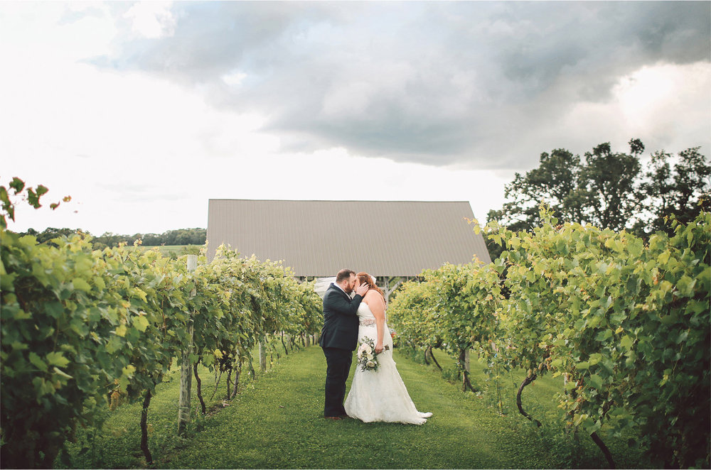 08-Cannon-Falls-Minnesota-Wedding-Photographer-by-Andrew-Vick-Photography-Summer-River-Winery-First-Meeting-Look-Bride-Groom-Kiss-Vineyard-Vintage-Becca-and-Donal.jpg