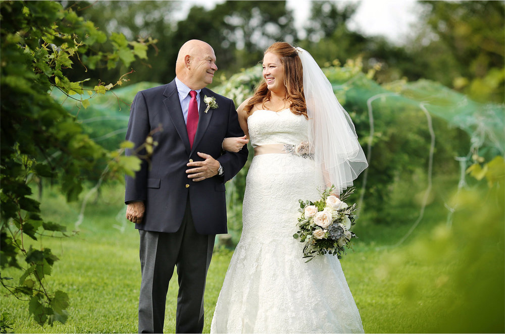 14-Cannon-Falls-Minnesota-Wedding-Photographer-by-Andrew-Vick-Photography-Summer-River-Winery-Ceremony-Bride-Father-Parents-Vineyard-Becca-and-Donal.jpg