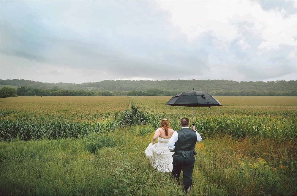 23-Cannon-Falls-Minnesota-Wedding-Photographer-by-Andrew-Vick-Photography-Summer-River-Winery-Bride-Groom-Farm-Field-Corn-Umbrella-Vintage-Becca-and-Donal.jpg