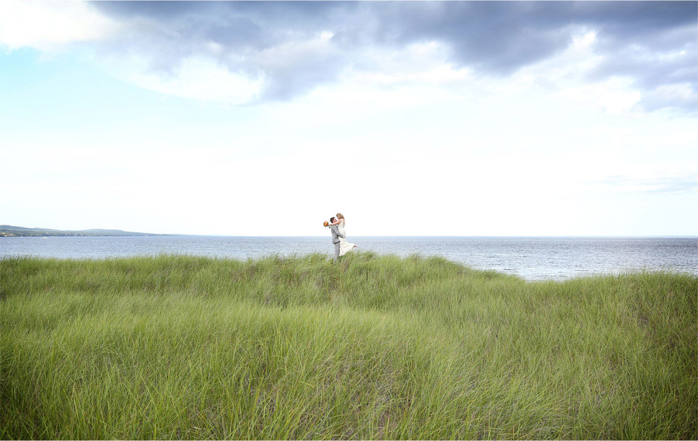 12-Duluth-Minnesota-Wedding-Photographer-by-Andrew-Vick-Photography-Summer-Bride-Groom-Lake-Superior-Grass-Lift-Katie-and-Andrew.jpg