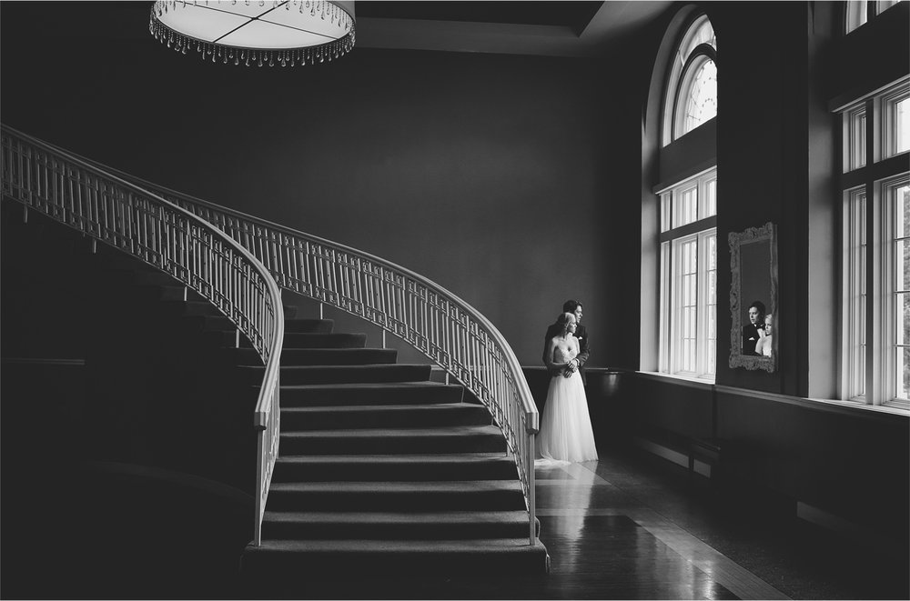 08-Minneapolis-Minnesota-Wedding-Photographer-by-Andrew-Vick-Photography-Summer-Calhoun-Beach-Club-First-Meeting-Look-Bride-Groom-Embrace-Staircase-Black-and-White-Michelle-and-Kevin.jpg