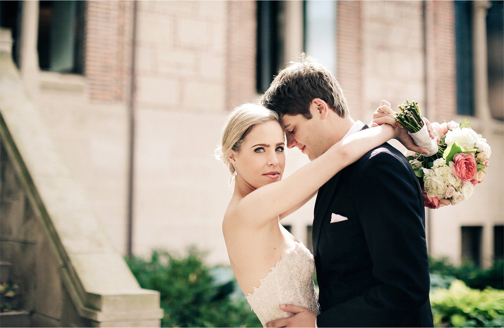 12-Saint-Paul-Minnesota-Wedding-Photographer-by-Andrew-Vick-Photography-Summer-Our-Lady-Of-Victory-Chapel-Church-Bride-Groom-Flowers-Embrace-Vintage-Michelle-and-Kevin.jpg