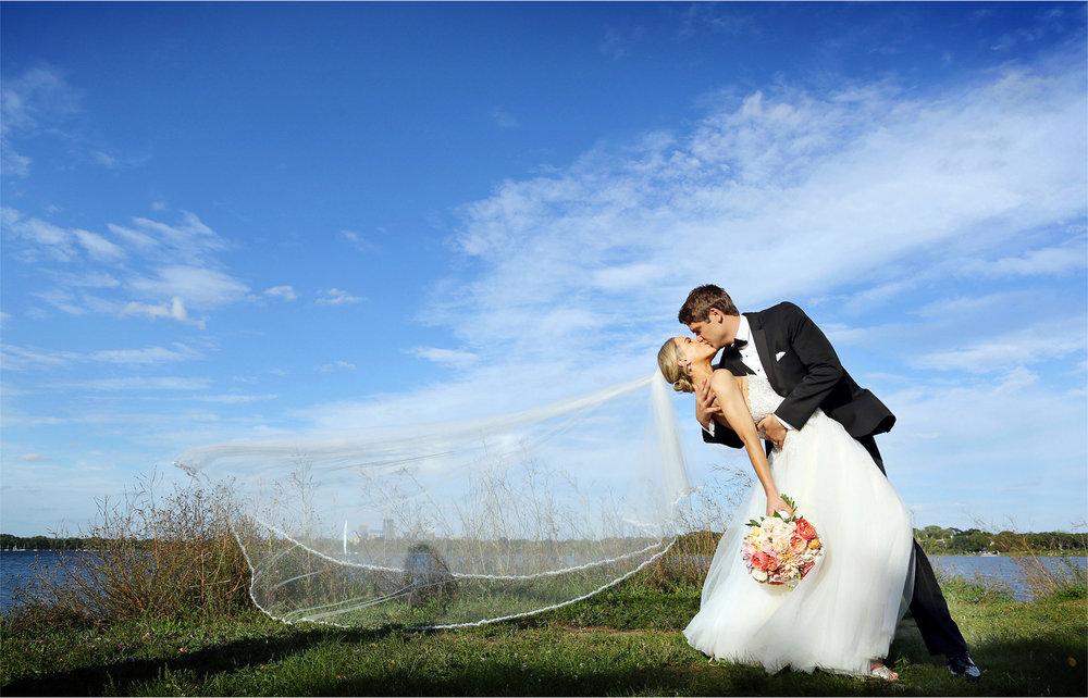 18-Minneapolis-Minnesota-Wedding-Photographer-by-Andrew-Vick-Photography-Summer-Lake-Calhoun-Bride-Groom-Flowers-Kiss-Dip-Veil-Michelle-and-Kevin.jpg