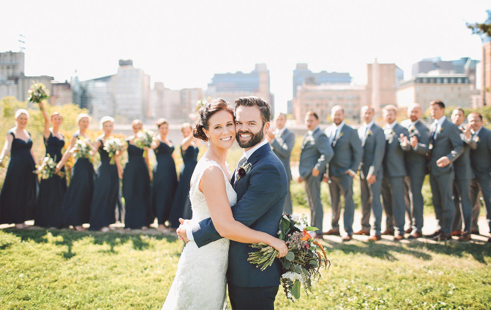 11-Minneapolis-Minnesota-Wedding-Photographer-by-Andrew-Vick-Photography-Summer-First-Meeting-Look-Bride-Groom-Bridal-Party-Bridesmaids-Groomsmen-Mississippi-River-Flowers-Vintage-Ashley-and-Eric.jpg