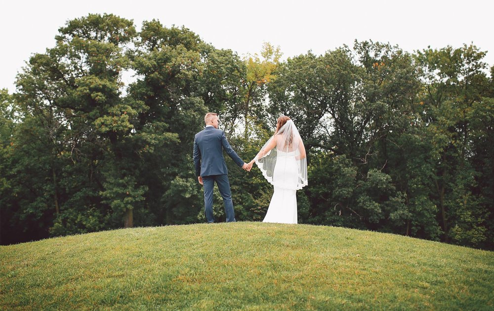 07-Dellwood-Minnesota-Wedding-Photographer-by-Andrew-Vick-Photography-Summer-Country-Club-First-Meeting-Look-Bride-Groom-Holding-Hands-Vintage-Sarah-and-Landon.jpg