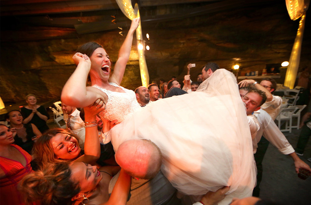 26-Bowling-Green-Kentucky-Wedding-Photographer-by-Andrew-Vick-Photography-Destination-Summer-Lost-River-Cave-Reception-Bride-Groom-Guests-Dance-Lift-Katie-and-Jon.jpg