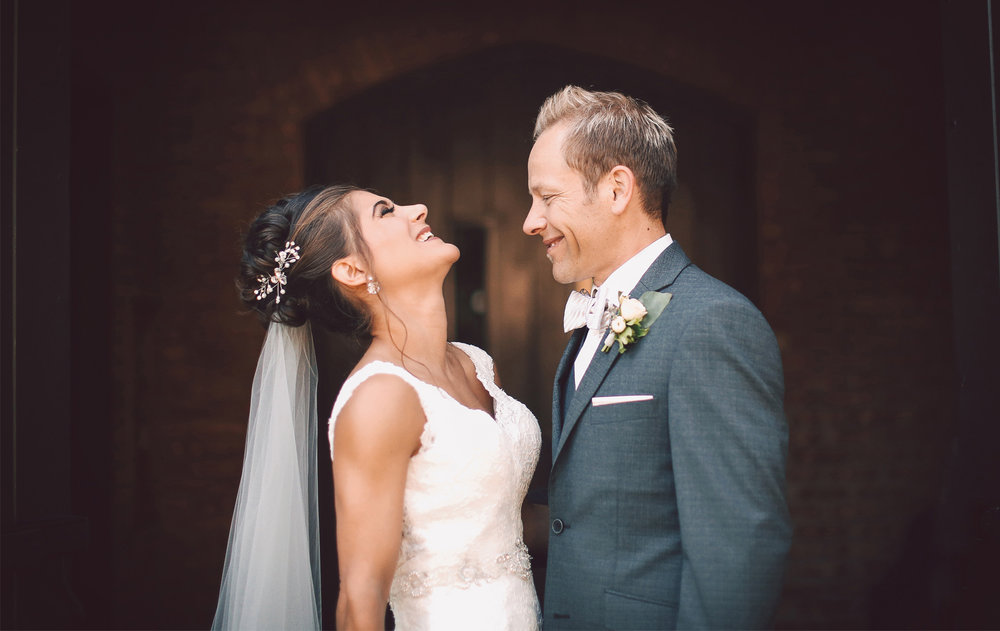 05-Saint-Louis-Park-Minnesota-Wedding-Photographer-by-Andrew-Vick-Photography-Fall-Autumn-Holy-Family-Catholic-Church-First-Meeting-Look-Bride-Groom-Laughter-Vintage-Paula-and-Jason.jpg