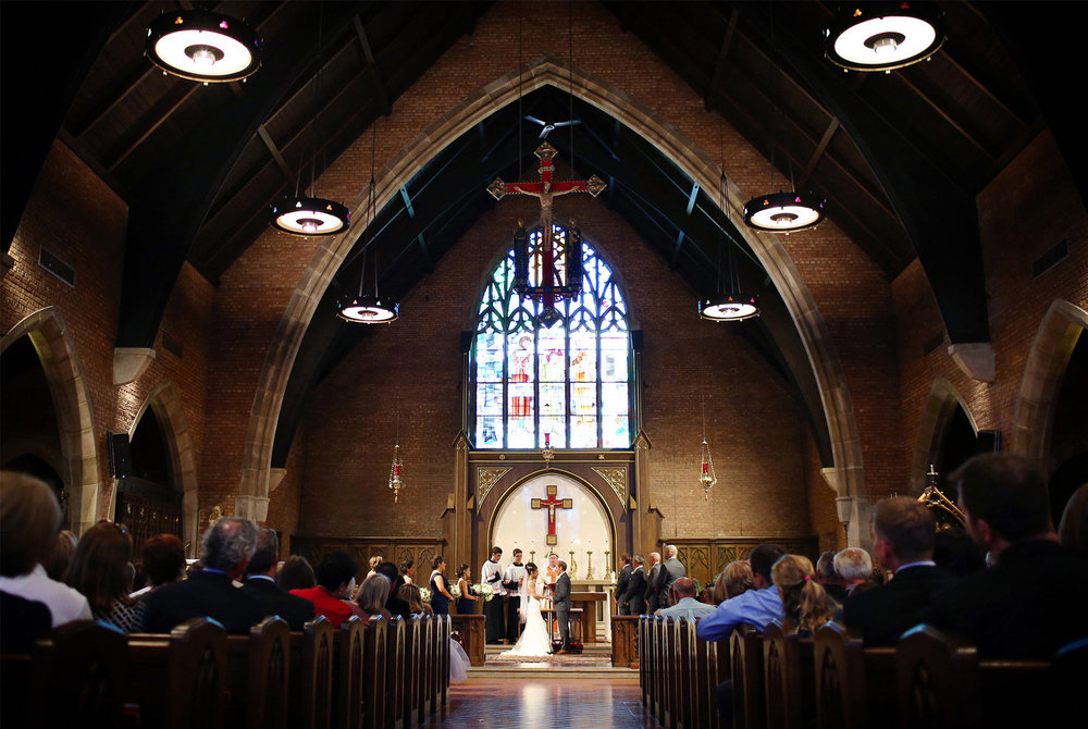 07-Saint-Louis-Park-Minnesota-Wedding-Photographer-by-Andrew-Vick-Photography-Fall-Autumn-Holy-Family-Catholic-Church-Ceremony-Bride-Groom-Vows-Paula-and-Jason.jpg