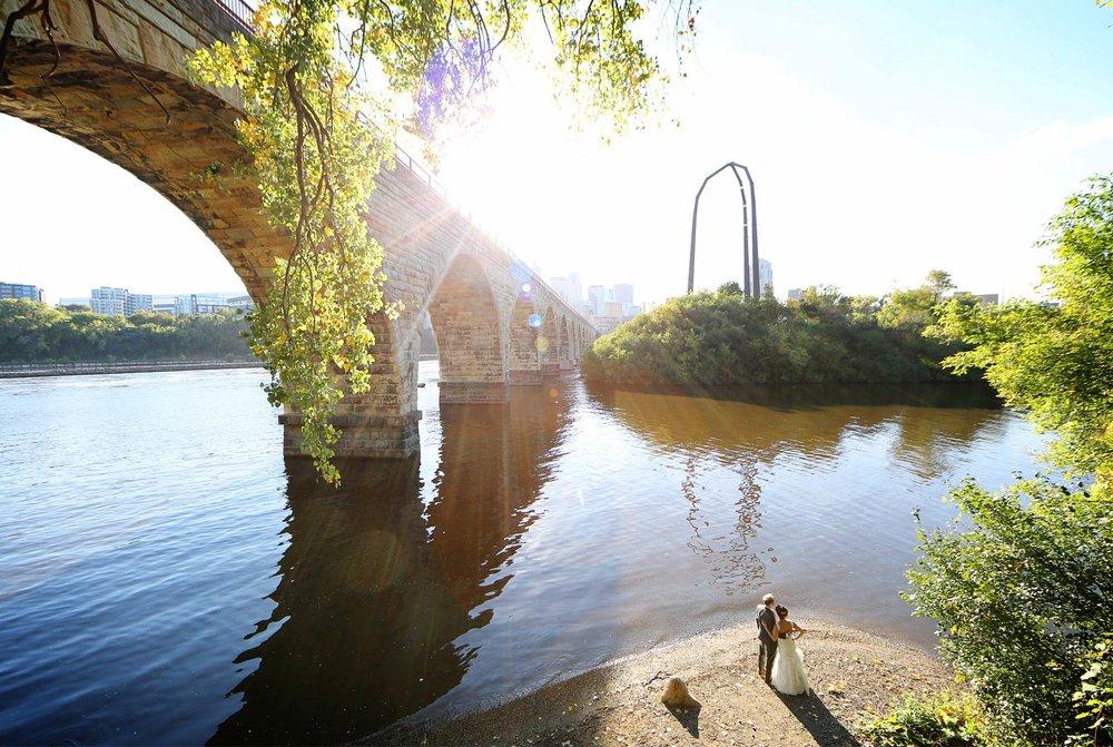 19-Minneapolis-Minnesota-Wedding-Photographer-by-Andrew-Vick-Photography-Fall-Autumn-Bride-Groom-Stone-Arch-Bridge-Mississippi-River-Paula-and-Jason.jpg
