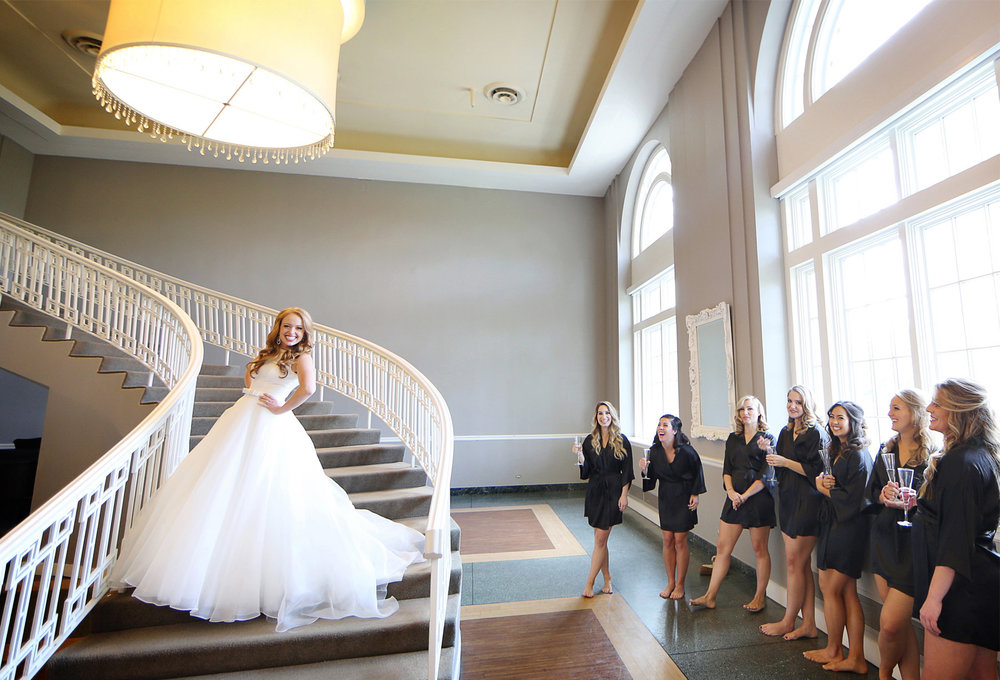 03-Minneapolis-Minnesota-Wedding-Photographer-by-Andrew-Vick-Photography-Fall-Autumn-Calhoun-Beach-Club-Getting-Ready-Bride-Bridesmaids-Dress-Staircase-Stairs-Champagne-Flutes-Kristy-and-Jack.jpg
