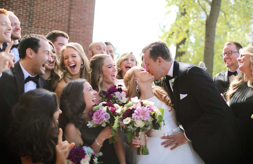 12-Minneapolis-Minnesota-Wedding-Photographer-by-Andrew-Vick-Photography-Fall-Autumn-Calhoun-Beach-Club-First-Look-Meeting-Bride-Groom-Bridesmaids-Groomsmen-Bridal-Party-Laughter-Kiss-Kristy-and-Jack.jpg
