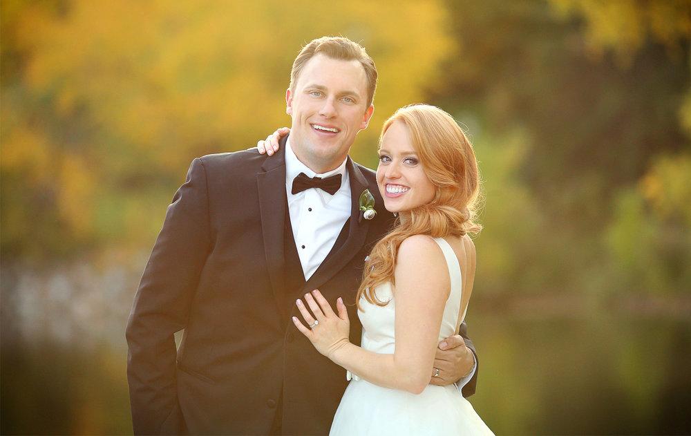 22-Minneapolis-Minnesota-Wedding-Photographer-by-Andrew-Vick-Photography-Fall-Autumn-Lake-Calhoun-Bride-Groom-Embrace-Kristy-and-Jack.jpg