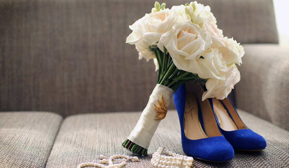 01-Minneapolis-Minnesota-Wedding-Photographer-by-Andrew-Vick-Photography-Fall-Autumn-Millennium-Hotel-Getting-Ready-Flowers-Shoes-Jewelry-Necklace-Bracelet-Amanda-and-Cary.jpg