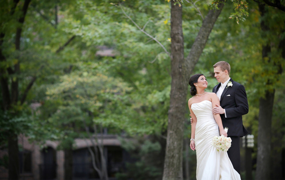 09-Minneapolis-Minnesota-Wedding-Photographer-by-Andrew-Vick-Photography-Fall-Autumn-Millennium-Hotel-First-Look-Meeting-Bride-Groom-Embrace-Amanda-and-Cary.jpg