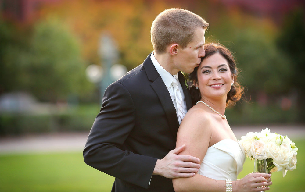 20-Minneapolis-Minnesota-Wedding-Photographer-by-Andrew-Vick-Photography-Fall-Autumn-Convention-Center-Bride-Groom-Champagne-Kiss-Amanda-and-Cary.jpg