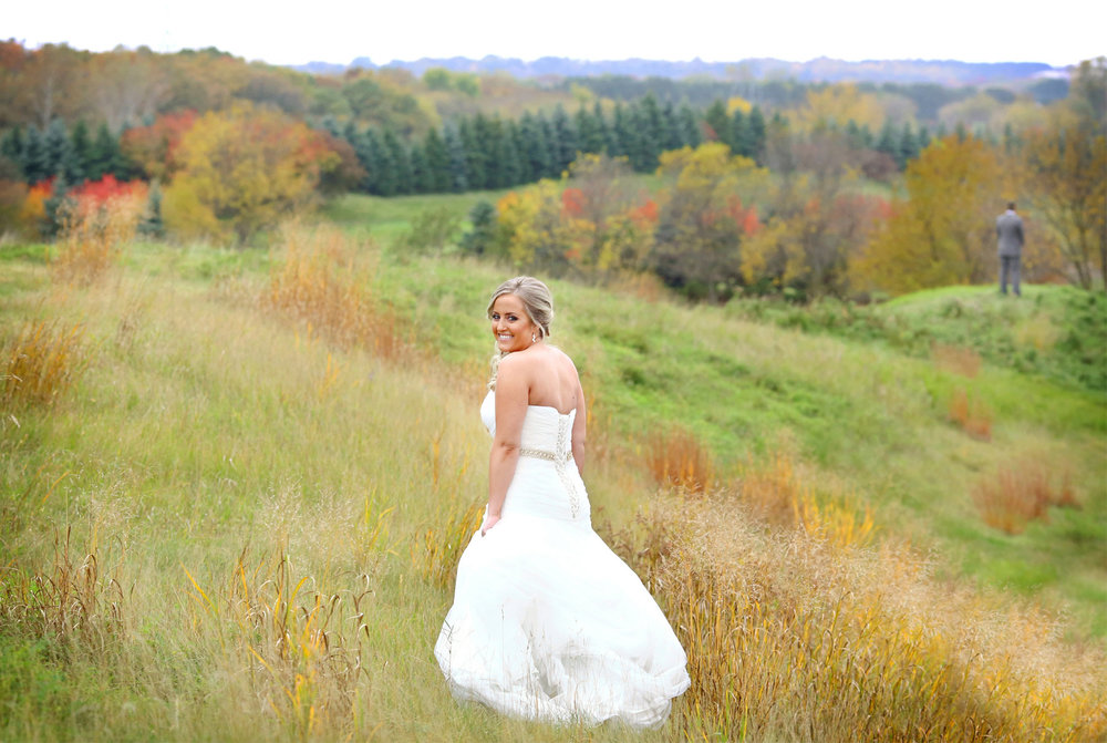 03-Stillwater-Minnesota-Wedding-Photographer-by-Andrew-Vick-Photography-Fall-Autumn-StoneRidge-Golf-Club-First-Meeting-Look-Bride-Groom-Hills-Field-Micaela-and-Derek.jpg