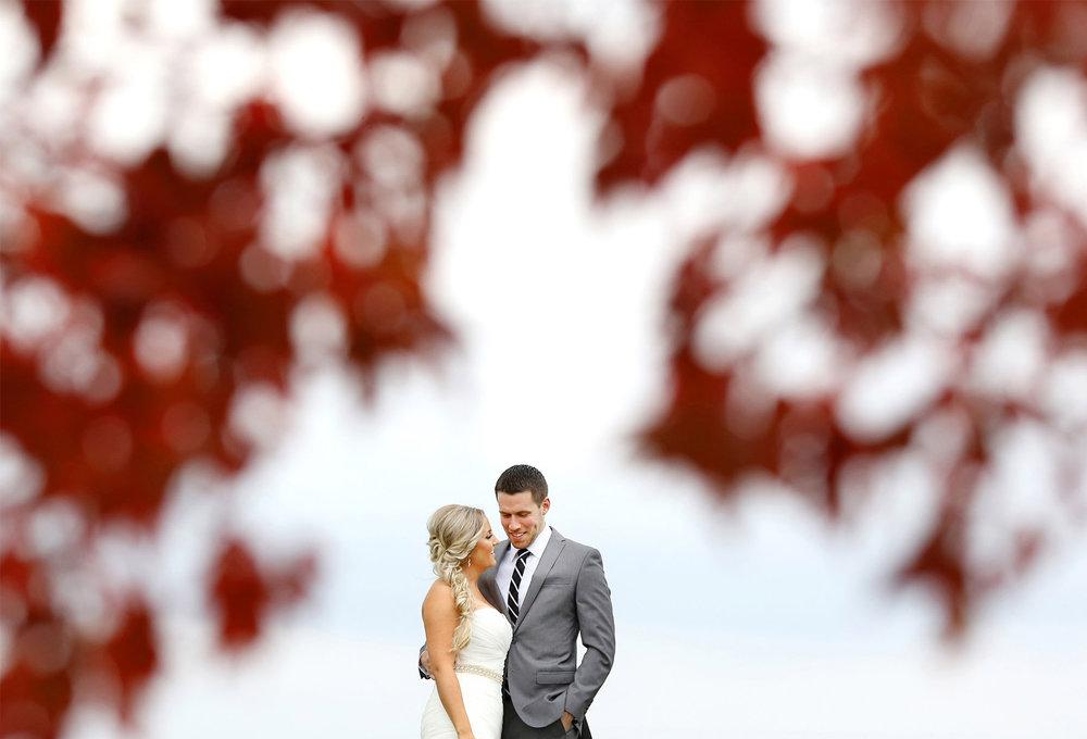08-Stillwater-Minnesota-Wedding-Photographer-by-Andrew-Vick-Photography-Fall-Autumn-StoneRidge-Golf-Club-First-Meeting-Look-Bride-Groom-Embrace-Hills-Field-Micaela-and-Derek.jpg