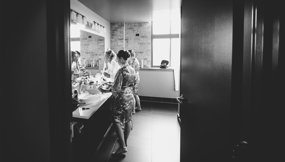 01-Milwaukee-Wisconsin-Wedding-Photographer-by-Andrew-Vick-Photography-Fall-Autumn-Destination-Iron-Horse-Hotel-Getting-Ready-Bride-Bridesmaids-Robes-Makeup-Black-and-White-Tina-and-Kevin.jpg