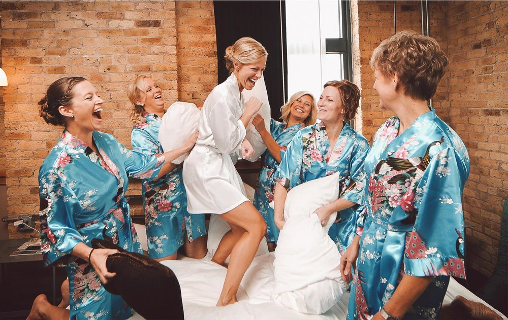 02-Milwaukee-Wisconsin-Wedding-Photographer-by-Andrew-Vick-Photography-Fall-Autumn-Destination-Iron-Horse-Hotel-Getting-Ready-Bride-Bridesmaids-Robes-Pillow-Fight-Vintage-Tina-and-Kevin.jpg