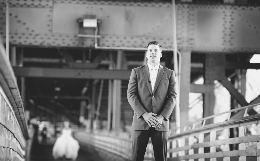 08-Milwaukee-Wisconsin-Wedding-Photographer-by-Andrew-Vick-Photography-Fall-Autumn-Destination-Holton-Bridge-Swing-Park-First-Meeting-Look-Bride-Groom-Black-and-White-Tina-and-Kevin.jpg