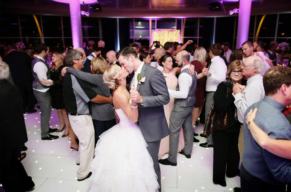 31-Milwaukee-Wisconsin-Wedding-Photographer-by-Andrew-Vick-Photography-Fall-Autumn-Discovery-World-Pilot-House-Destination-Bride-Groom-Dance-Kiss-Guests-Tina-and-Kevin.jpg