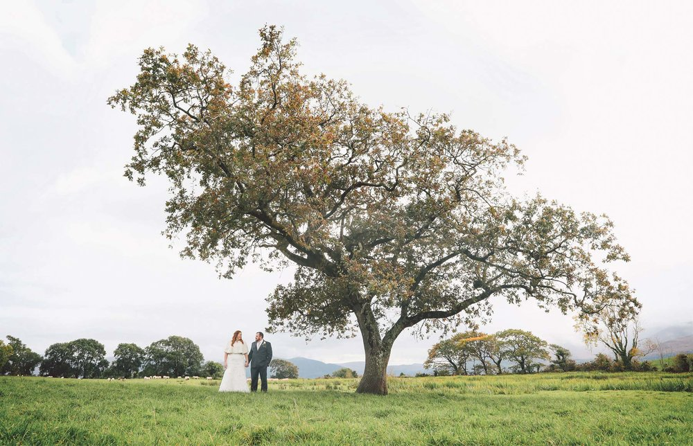31-Kilarney-Ireland-Wedding-Photographer-by-Andrew-Vick-Photography-Fall-Autumn-Destination-Bride-Groom-Field-Vintage-Becca-and-Donal.jpg