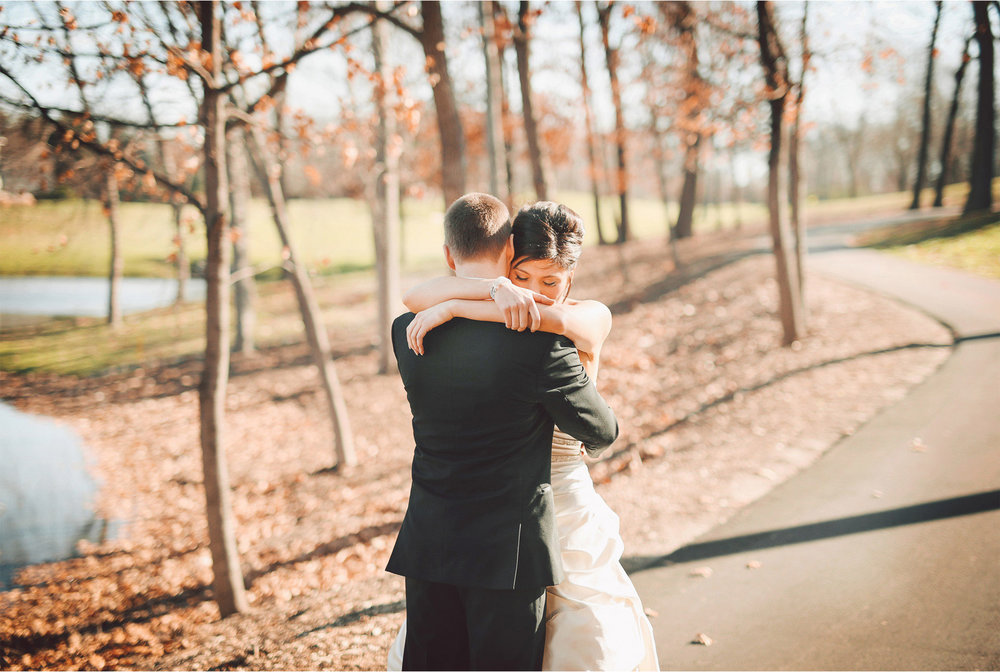 05-Eden-Prairie-Minnesota-Wedding-Photographer-by-Andrew-Vick-Photography-Fall-Autumn-Bearpath-Golf-Country-Club-First-Meeting-Look-Bride-Groom-Embrace-Hug-Vintage-Brittany-and-Ryan.jpg