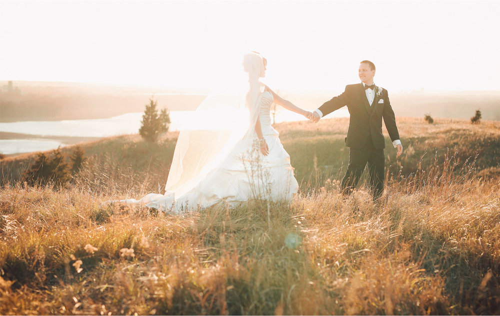 19-Eden-Prairie-Minnesota-Wedding-Photographer-by-Andrew-Vick-Photography-Fall-Autumn-Bearpath-Golf-Country-Club-Bride-Groom-Field-Holding-Hands-Vintage-Brittany-and-Ryan.jpg