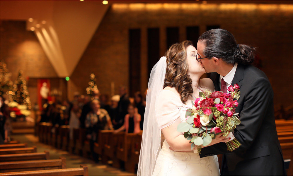 15-Edina-Minnesota-Wedding-Photographer-by-Andrew-Vick-Photography-Winter-Saint-Patricks-Catholic-Church-Ceremony-Bride-Groom-Kiss-Recessional-Elizabeth-and-Brian.jpg.jpg