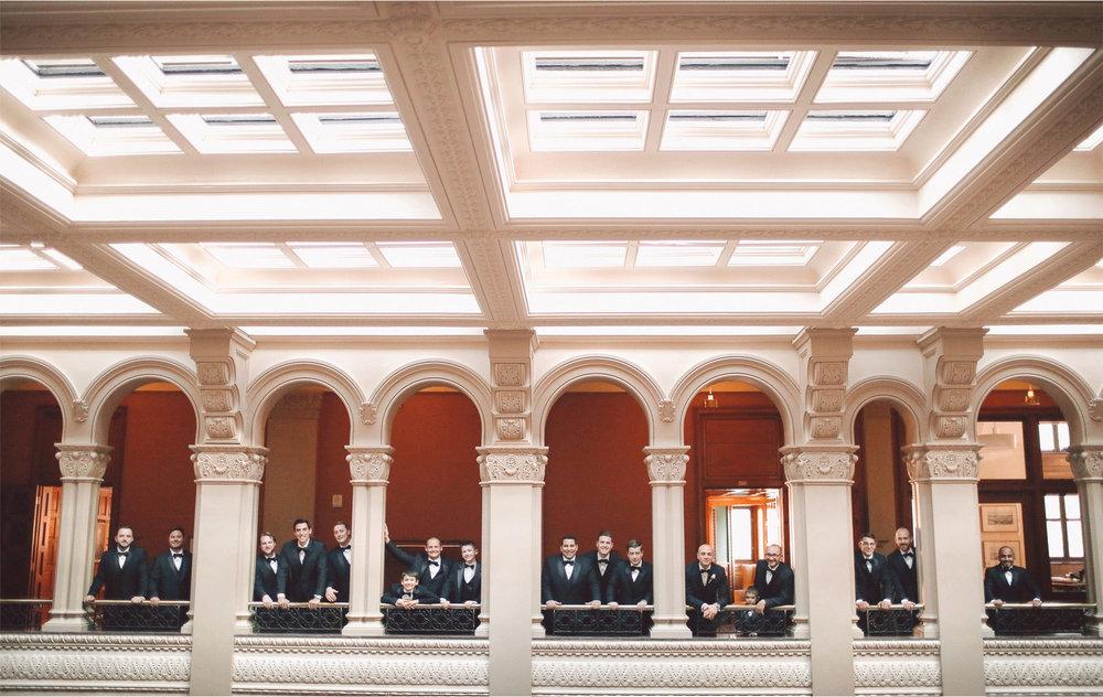 08-Saint-Paul-Minnesota-Wedding-Photographer-by-Andrew-Vick-Photography-Winter-New-Years-Eve-Landmark-Center-Groom-Groomsmen-Balcony-Vintage-Emily-and-Michael.jpg