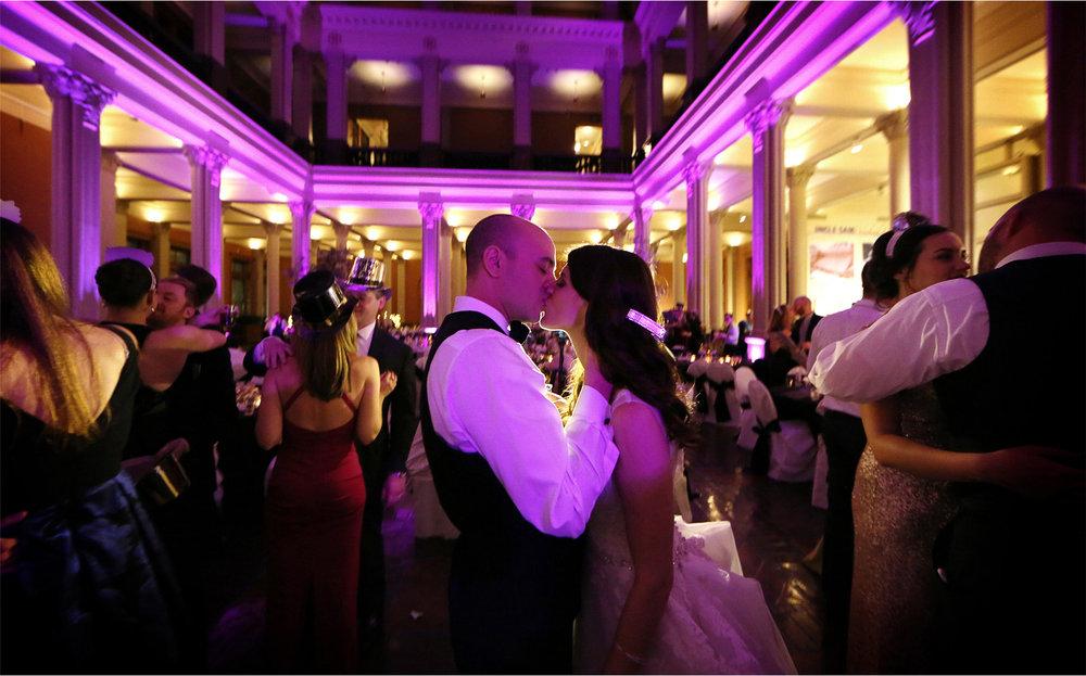 23-Saint-Paul-Minnesota-Wedding-Photographer-by-Andrew-Vick-Photography-Winter-New-Years-Eve-Landmark-Center-Reception-Bride-Groom-Guests-Dance-Kiss-Emily-and-Michael.jpg