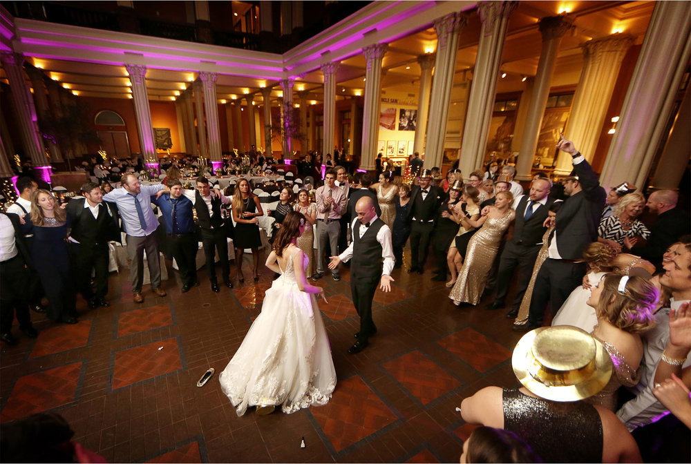 24-Saint-Paul-Minnesota-Wedding-Photographer-by-Andrew-Vick-Photography-Winter-New-Years-Eve-Landmark-Center-Reception-Bride-Groom-Guests-Dance-Emily-and-Michael.jpg