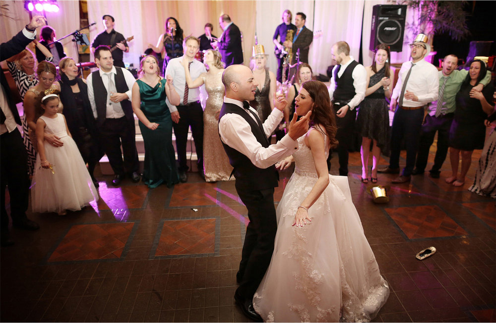 25-Saint-Paul-Minnesota-Wedding-Photographer-by-Andrew-Vick-Photography-Winter-New-Years-Eve-Landmark-Center-Reception-Bride-Groom-Guests-Dance-Singing-Emily-and-Michael.jpg