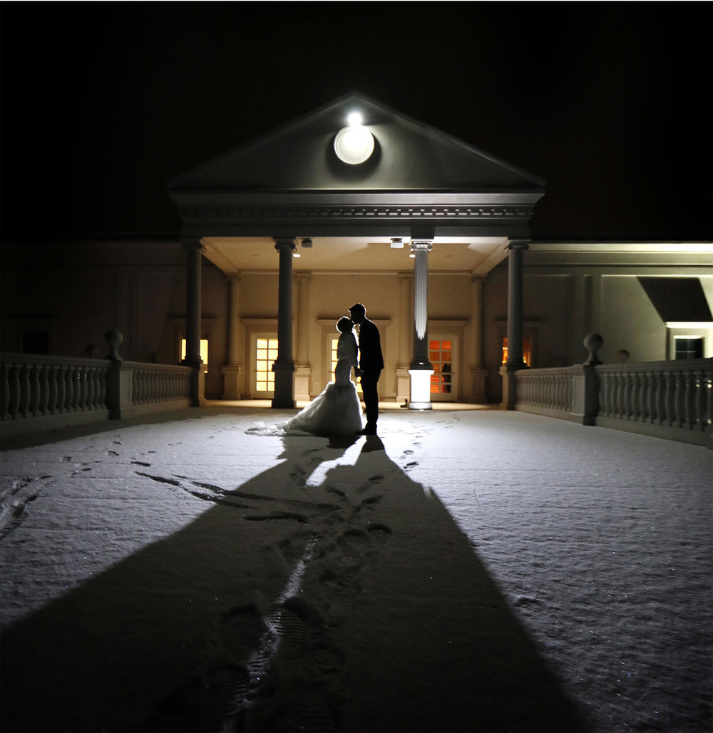 25-Somerset-New-Jersey-Wedding-Photographer-by-Andrew-Vick-Photography-Winter-Palace-At-Somerset-Park-Reception-Bride-Groom-Kiss-Silhouette-Night-Alexia-and-Justin.jpg