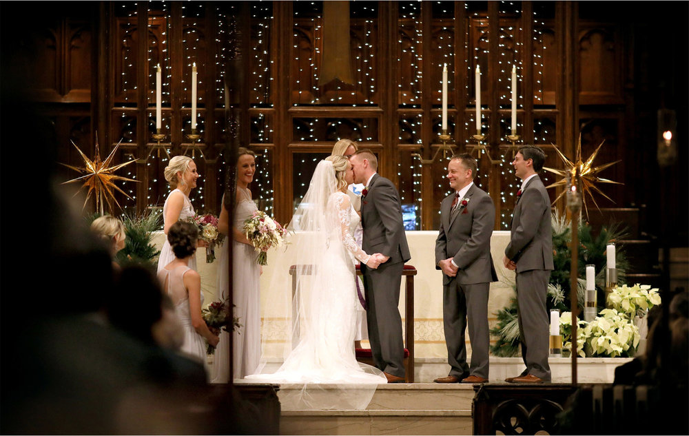 15-Minneapolis-Minnesota-Wedding-Photographer-by-Andrew-Vick-Photography-Winter-Central-Lutheran-Church-Ceremony-Bride-Groom-Kiss-Brittany-and-Joseph.jpg
