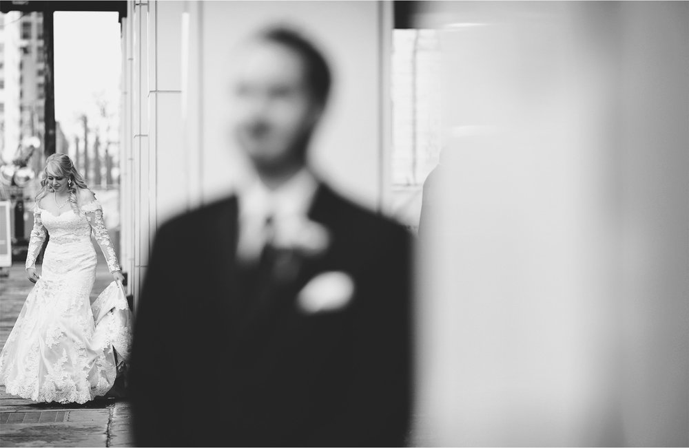 03-Minneapolis-Minnesota-Wedding-Photographer-by-Andrew-Vick-Photography-Winter-Millennium-Hotel-First-Meeting-Look-Bride-Groom-Black-and-White-Jennifer-and-Phillip.jpg