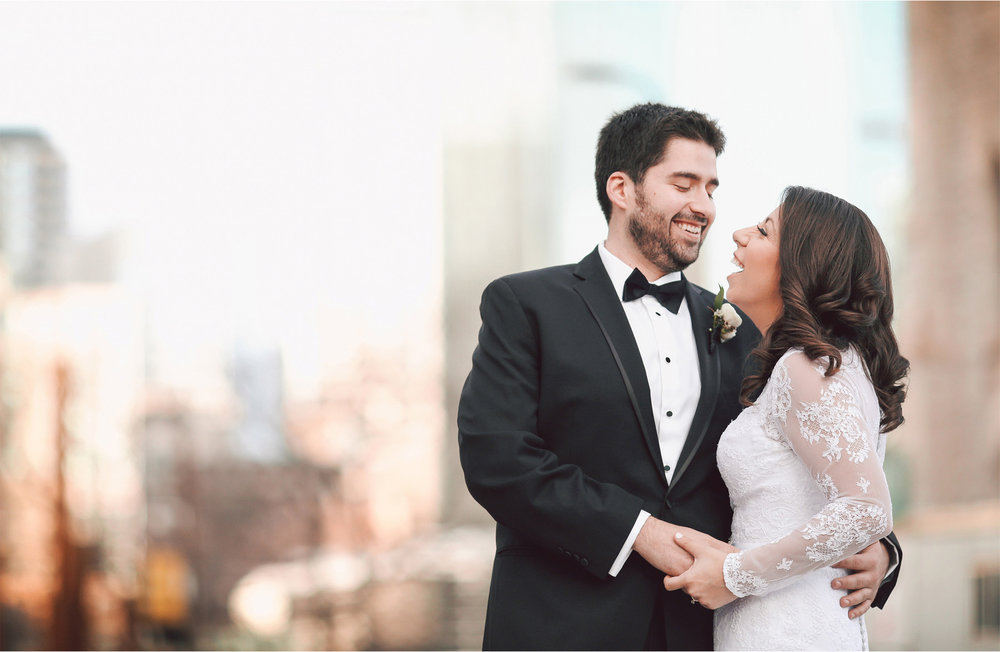 06-Minneapolis-Minnesota-Wedding-Photographer-by-Andrew-Vick-Photography-Winter-Millennium-Hotel-First-Meeting-Look-Bride-Groom-Downtown-Laughter-Vintage-Amy-and-Jordan.jpg