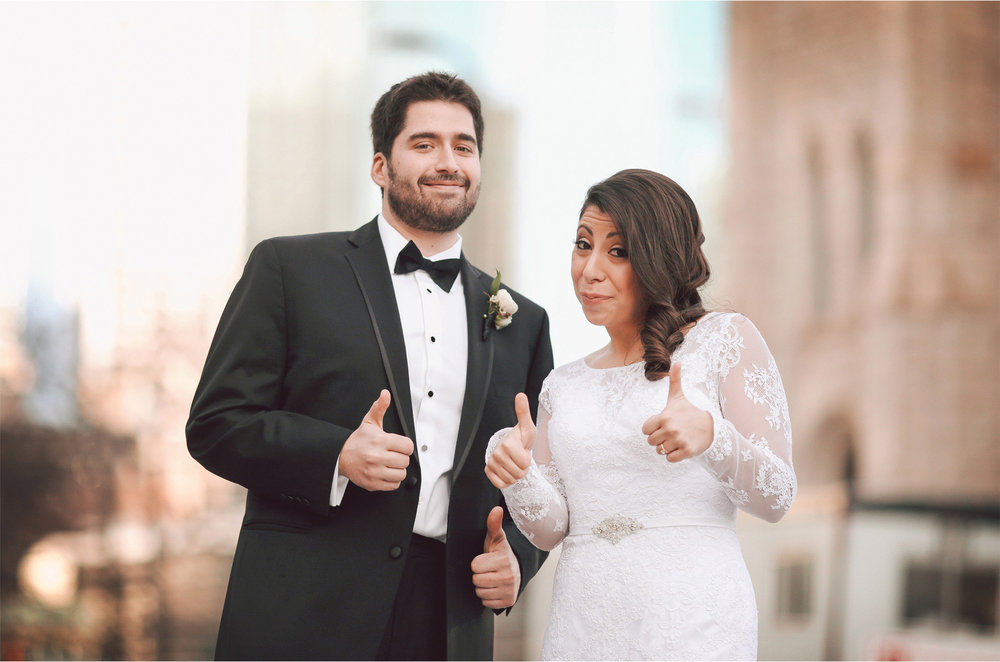 07-Minneapolis-Minnesota-Wedding-Photographer-by-Andrew-Vick-Photography-Winter-Millennium-Hotel-First-Meeting-Look-Bride-Groom-Downtown-Thumbs-Up-Vintage-Amy-and-Jordan.jpg