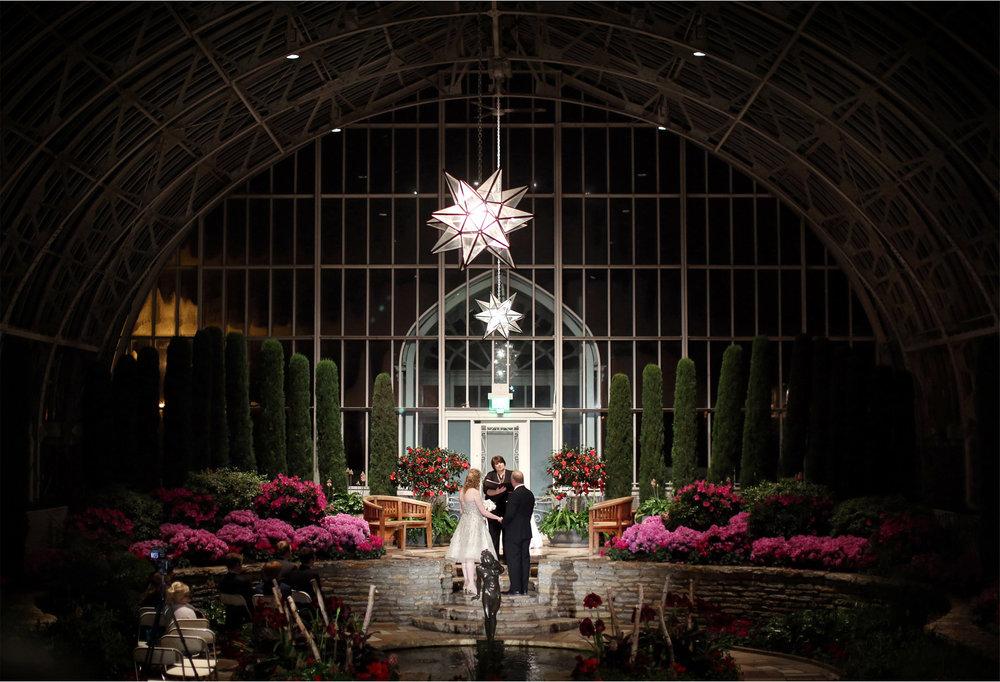 12-Saint-Paul-Minnesota-Wedding-Photographer-by-Andrew-Vick-Photography-Winter-Como-Park-Conservatory-Sunken-Garden-Ceremony-Bride-Groom-Vows-Flowers-Night-Dannette-and-Darren.jpg
