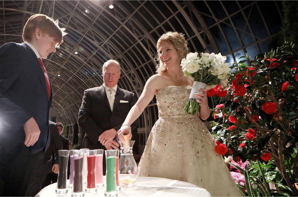 13-Saint-Paul-Minnesota-Wedding-Photographer-by-Andrew-Vick-Photography-Winter-Como-Park-Conservatory-Sunken-Garden-Ceremony-Bride-Groom-Son-Family-Colored-Sand-Flowers-Night-Dannette-and-Darren.jpg
