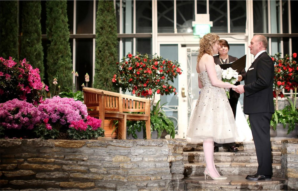 15-Saint-Paul-Minnesota-Wedding-Photographer-by-Andrew-Vick-Photography-Winter-Como-Park-Conservatory-Sunken-Garden-Ceremony-Bride-Groom-Vows-Flowers-Night-Dannette-and-Darren.jpg