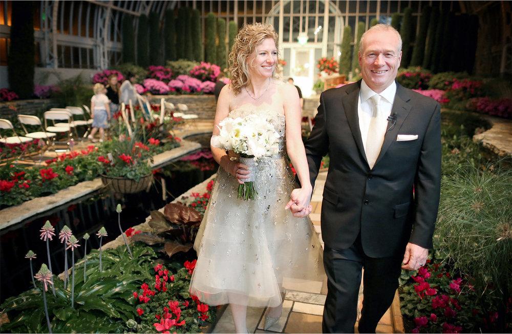 17-Saint-Paul-Minnesota-Wedding-Photographer-by-Andrew-Vick-Photography-Winter-Como-Park-Conservatory-Sunken-Garden-Ceremony-Bride-Groom-Recessional-Flowers-Night-Dannette-and-Darren.jpg