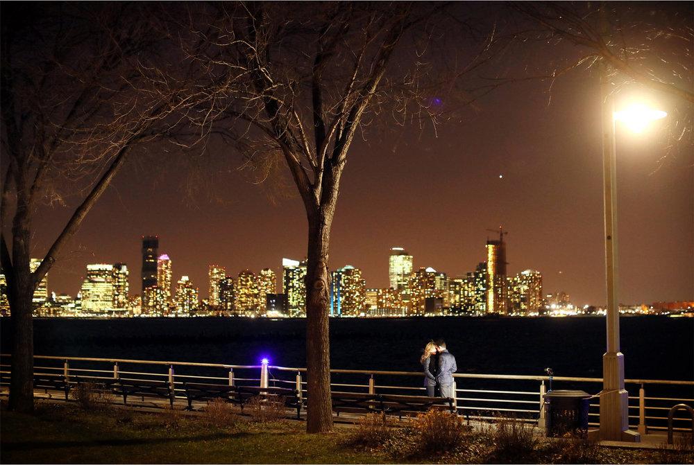 07-New-York-City-Wedding-Photographer-by-Andrew-Vick-Photography-Winter-Engagement-Bride-Groom-Night-Embrace-Harbor-Emily-and-Jon.jpg