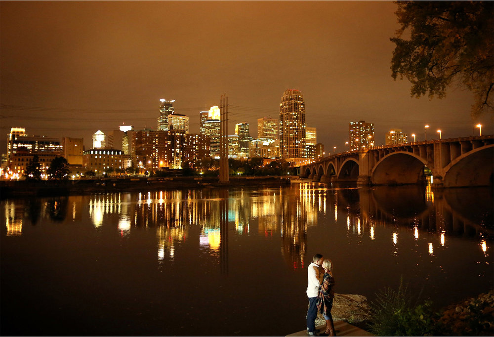 12-Minneapolis-Minnesota-Wedding-Photographer-by-Andrew-Vick-Photography-Fall-Autumn-Engagement-Bride-Groom-Downtown-Skyline-Stone-Arch-Bridge-Night-Embrace-Mississippi-River-Mallory-and-Kyle.jpg