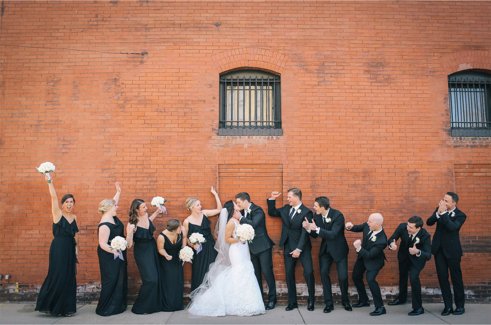 08-Minneapolis-Minnesota-Wedding-Photographer-by-Andrew-Vick-Photography-Aria-Spring-Bride-Groom-Bridal-Party-Bridesmaids-Groomsmen-Kiss-Cheering-Alex-and-Andy.jpg