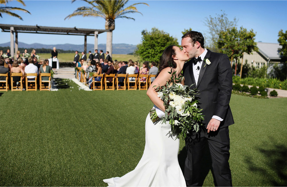 17-Napa-California-Wedding-Photographer-by-Andrew-Vick-Photography-Spring-Destination-Carneros-Resort-and-Spa-Ceremony-Bride-Groom-Kiss-Recessional-Alex-and-Roger.jpg